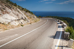Left turn of mountain highway Stock Images