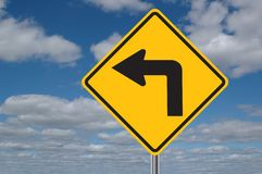 Left Turn Sign with Clouds. Left turn traffic sign with clouds in the background royalty free stock photo