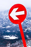 Left turn sign on a red track. Left turn sign on a red marked ski track stock photos