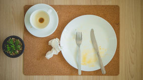 Leftover breakfast on table. stock images