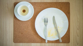 Leftover breakfast on table. royalty free stock photo