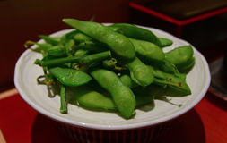 Leftover of Edamame beans skin after being consumed. Typically as appetizer. Edamame is a preparation of immature soybeans in the pods which are boiled or Stock Photography