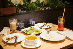 Leftover food. Leftover dinner food sits on a table at a restaurant Stock Images
