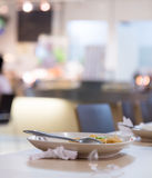 Leftover food on a plate. In the dining room Royalty Free Stock Photos