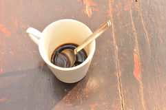 Leftover hot coffee on wooden background Stock Photos