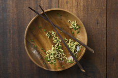 Leftover noodles on dining table Royalty Free Stock Photography