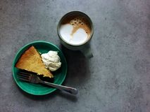 Leftover Thanksgiving pumpkin pie cheesecake and latte for breakfast Stock Images