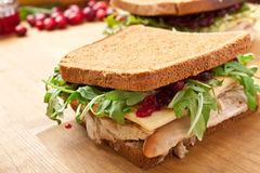 Leftover Turkey Sandwich with Cranberry Sauce. Leftover Turkey Breast Sandwich with Cranberry Sauce and Rocket on Whole Wheat Bread Stock Photos