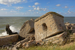 Leftovers of bombed sovjet bunkers in the Baltic sea at Karosta. Waves splashing against remains of destroyed sovjet bunkers in the Baltic sea, part of a fort in Royalty Free Stock Photography