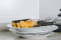 Leftovers and grungy tableware. Stock Photos