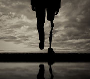 Leg with artificial limb black and white reflection Stock Photography