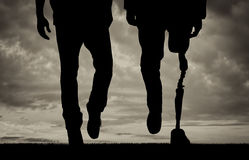 Leg with artificial limb and normal feet black and white Royalty Free Stock Photos