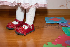 Leg of baby on the floor with puzzles Royalty Free Stock Images