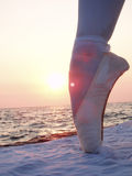 Leg in ballet shoes. Leg in pink satin ballet shoes royalty free stock images