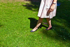 Leg of beautiful girl. Walking on the green Royalty Free Stock Images