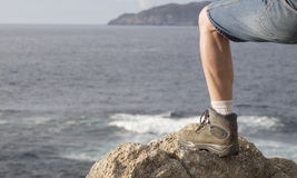 Leg with a boot on a seascape Royalty Free Stock Photos