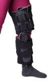 Leg brace. Leg with knee brace - isolated on white royalty free stock photo