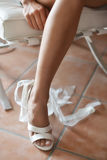 Leg of bride in white shoes. Leg of young bride in traditional white wedding shoes Stock Photos
