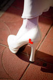 Leg of bride in white shoes Stock Photography