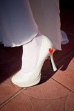 Leg of bride in white shoes Royalty Free Stock Photography