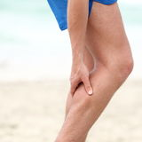 Leg calf sport muscle injury. Runner with muscle pain in leg Royalty Free Stock Photo