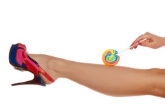 Leg and candy Stock Photos