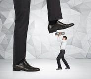 Leg comes on businessman Stock Image