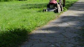 Leg cut grass stone path stock footage
