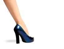 Leg in dark blue a shoe on a high heel Stock Photos