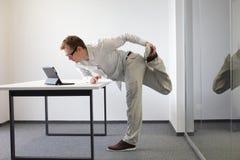 Leg exercise durrng office work Stock Photo