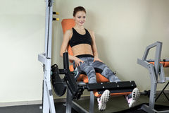 Leg Exercises - Young Woman Doing Leg With Machine In Gym stock photo