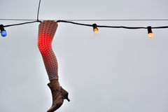 Leg of a fashion doll used as a light ornament Stock Photo