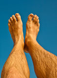 Leg and feet of a man with blue sky Stock Photography