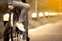 Leg and feet of young couple riding a bicycle togetherp stock photography