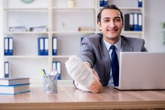 The leg injured male employee in the office. Leg injured male employee in the office royalty free stock photography