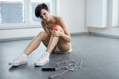 Leg Injury. Beautiful Woman Feeling Pain In Knee, Painful Knee Royalty Free Stock Photography