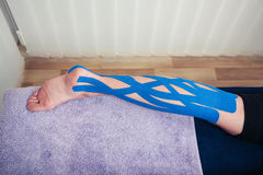 Leg with kinesio tape Royalty Free Stock Image