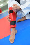Leg with knee in protective ankle brace Stock Photo
