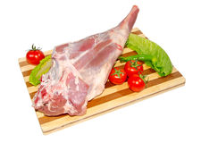 Leg of lamb. Raw leg of lamb on a cutting board Royalty Free Stock Photos
