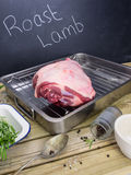 Leg of lamb with ingredients for roast lamb Royalty Free Stock Image
