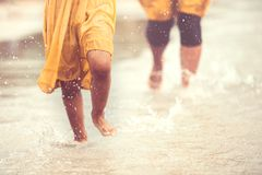 Leg of little child girl running on beach with water splashing. In summer vacation in vintage color tone stock photo