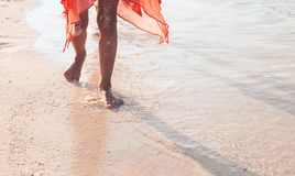 Leg of little child girl running on beach with water splashing. In summer vacation stock photos