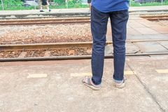 Leg male of travel put jeans stand wait train in station trail platform with copy space. Leg male of travel put jeans stand wait train in station  trail platform Stock Images