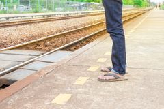 Leg male of travel put jeans stand wait train in station trail platform with copy space. Leg male of travel put jeans stand wait train in station  trail platform Stock Image