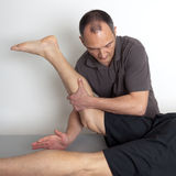 Leg manipulation Royalty Free Stock Image