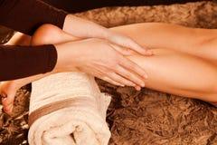 Leg massage. Technique in spa Stock Image