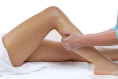 Leg massage. Therapist giving a leg massage Stock Photos