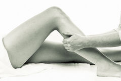 Leg massage. Therapist givinig a leg massage Royalty Free Stock Image