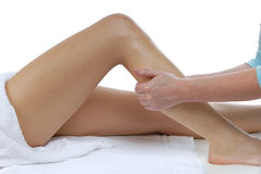 Leg massage. Therapist givinig a leg massage Stock Photography