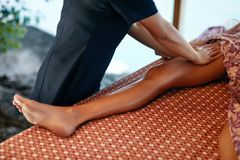 Leg Massage. Closeup Of Massaging Therapy With Oil At Thai Spa. Body Care Procedure At Massage Salon. High Resolution royalty free stock image
